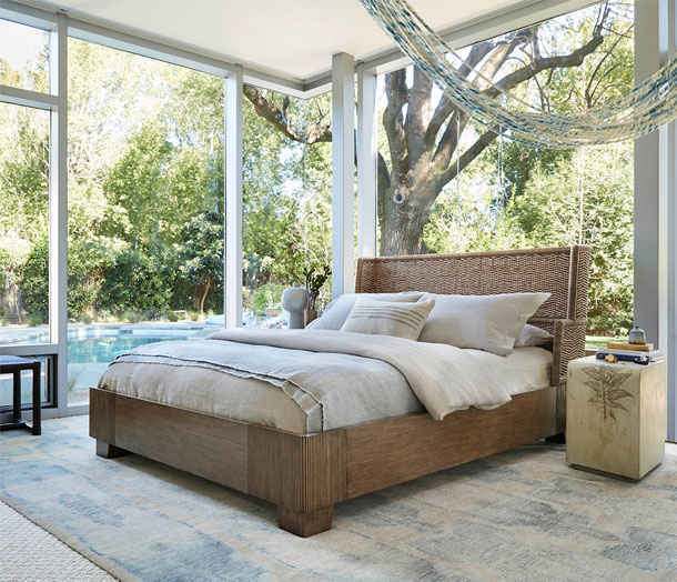 McGuire Furniture bed shot with rectangular concrete side table with artichoke leaf impression