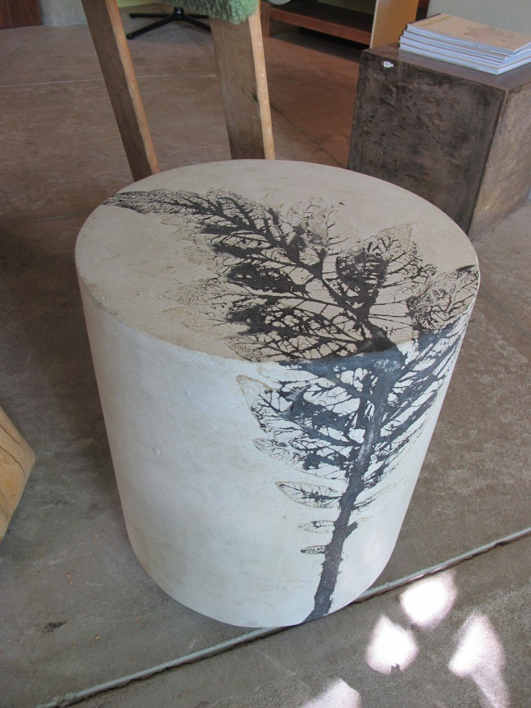 Concrete stool with black and white artichoke leaf impression