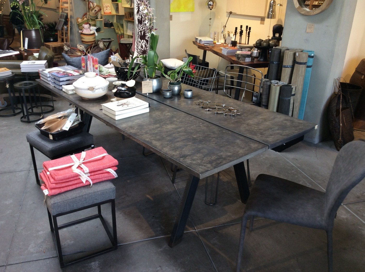 Bisected concrete dining table with steel base at The Gardener in Berkeley, CA